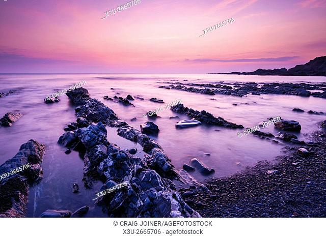 The rocky shore at Speke's Mill Mouth on the North Devon coast at dusk near Hartland, England