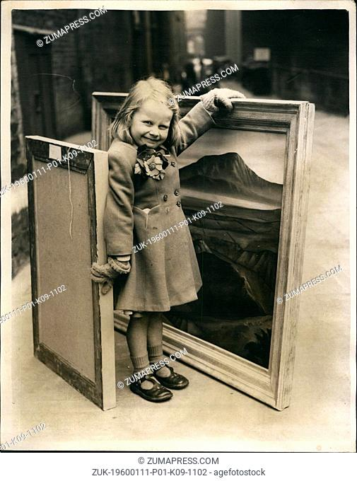 1955 - The youngster and the paintings. Sending in for 'oils' at Royal Academy. Photo shows four year old Jennifer Barton of Paddington - keeps a wary eye on...