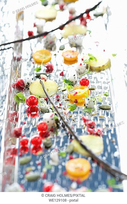 Finely sliced fruit on a silver tray