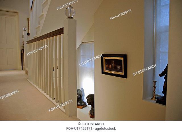 Cream carpet on cream landing in small loft conversion