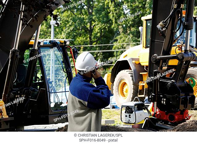 Engineer on phone on construction site