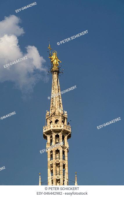 Italy, Milan, golden Madonna on top of Milan Cathedral