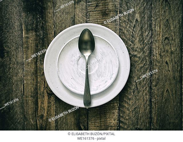 Dish and spoon on wood