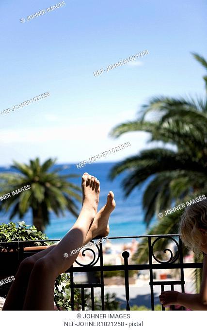 Girls relaxing in balcony