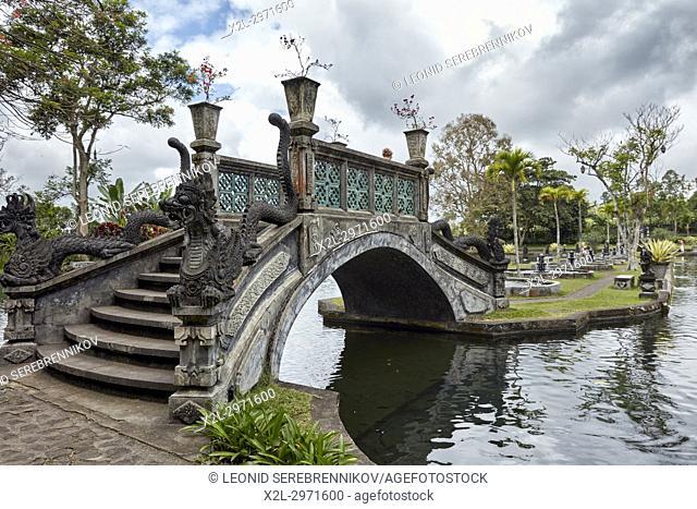 Bridge with dragon stone carvings in Tirta Gangga water palace, a former royal palace. Karangasem regency, Bali, Indonesia