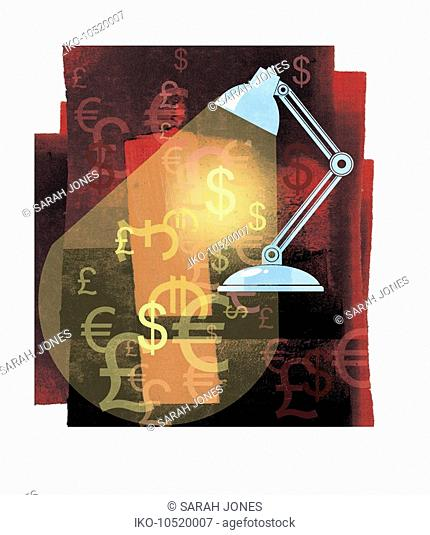 Desk lap spotlighting foreign currency symbols