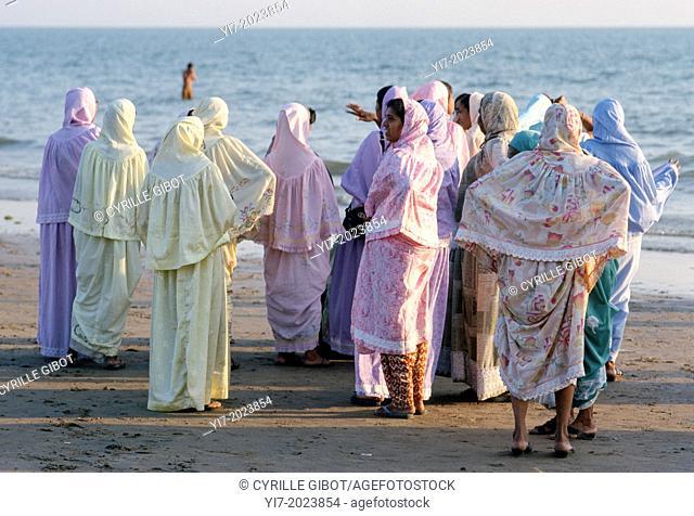 Muslim women on a beach, Mandvi, Gujarat, India