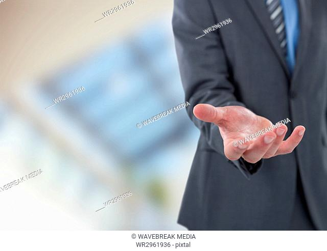 Midsection of businessman offering hand