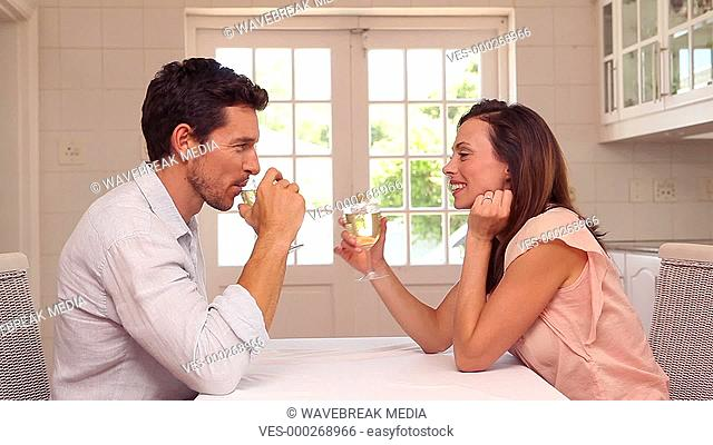 Happy man giving his partner a present at the table