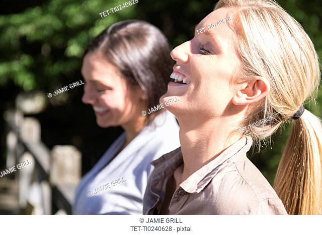 Two women smiling outdoors