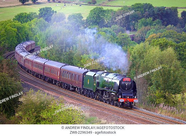 Steam locomotive LMS Princess Coronation Class 46233 'Duchess of Sutherland' near Low Baron Wood Farm Armathwaite Eden Valley, Cumbria, England, UK