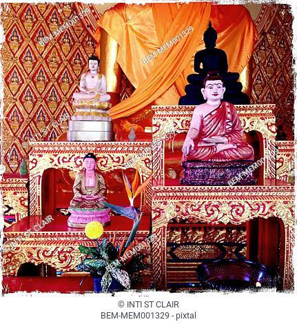Ornate Buddha statues in temple, Wat Chayamangkalaram, Penang, Malaysia