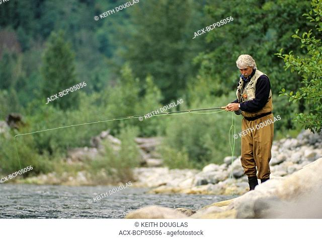 Flyfisherman along bank, Dean river, British Columbia, Canada