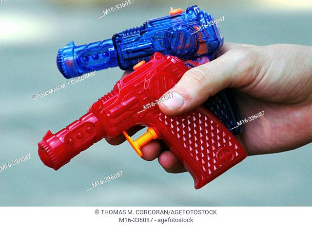 Two water guns in a hand