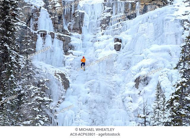 Ice climber on frozen Tangle Falls, Jasper National Park, Alberta, Canada