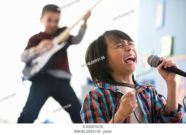 Boys playing in band together