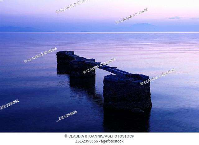 Old jetty in the Pagasitic Gulf at the coast of Pelion Peninsula (Greece) after sunset