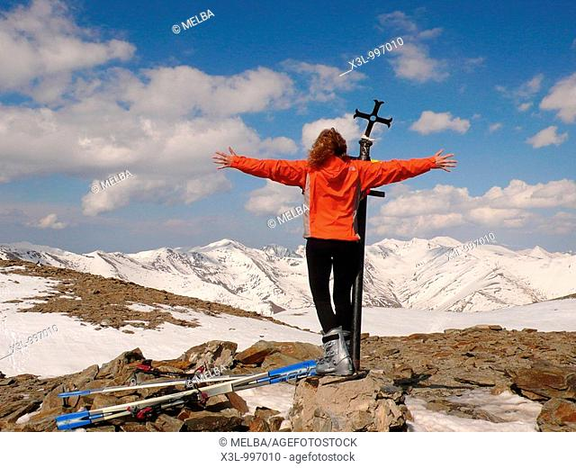 Skier trekking in the top of Puigmal mountain victorious and happy  Pyrenees  Lerida  Catalonia  Spain