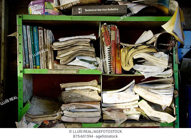 Bookcase at car repair shop