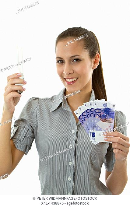Woman with energy-saving lamp and euro bills