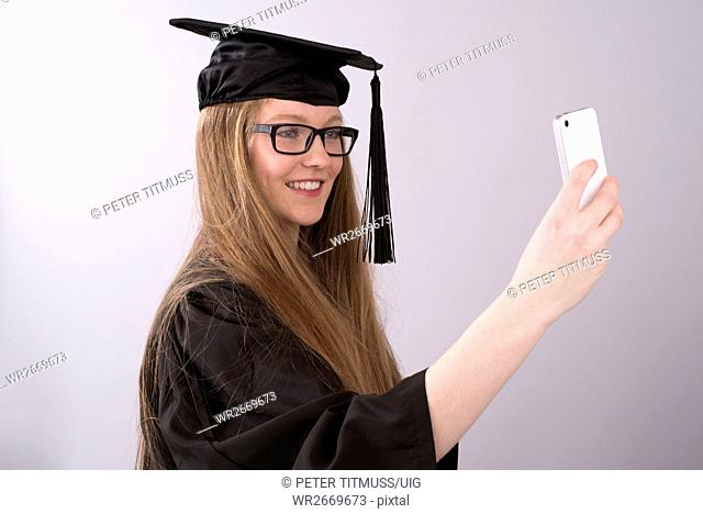 University student taking a selfie picture on her phone