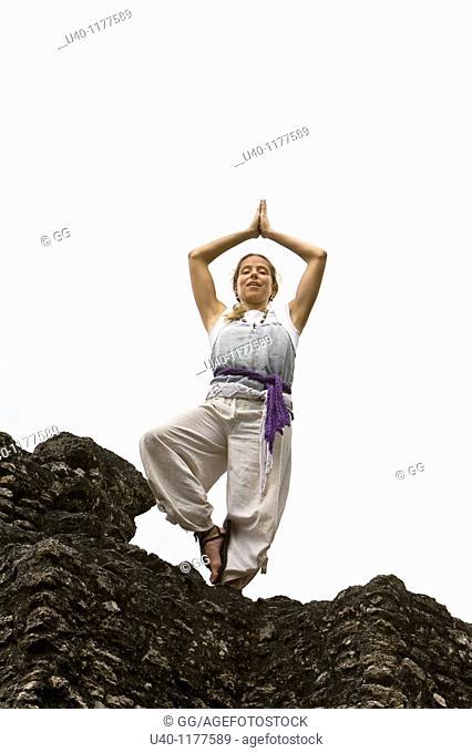Guatemala, Tikal, woman doing Yoga