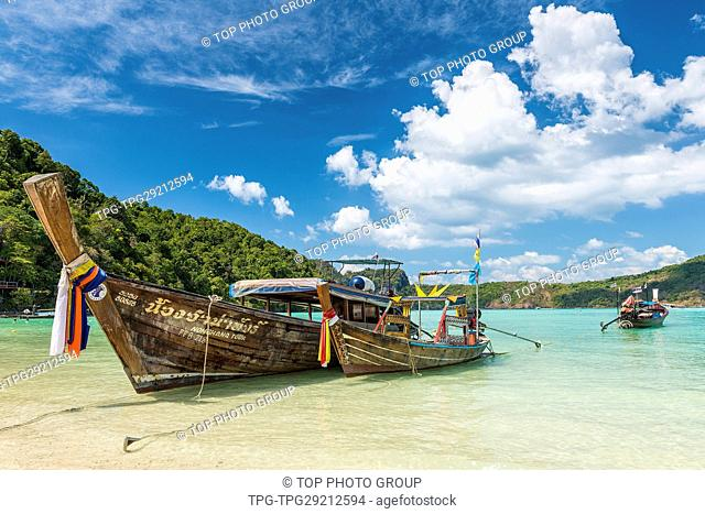 Traditional thai longtail boat at Log Dalum Beach on Phi Phi Don island; Thailand in a summer day