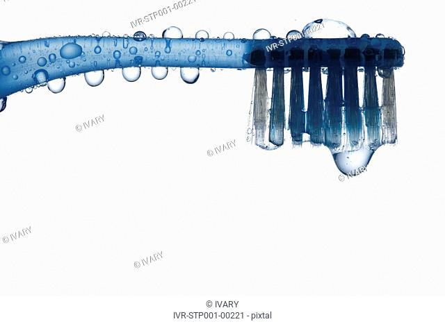 Tooth Brush With Water Drops And White Background