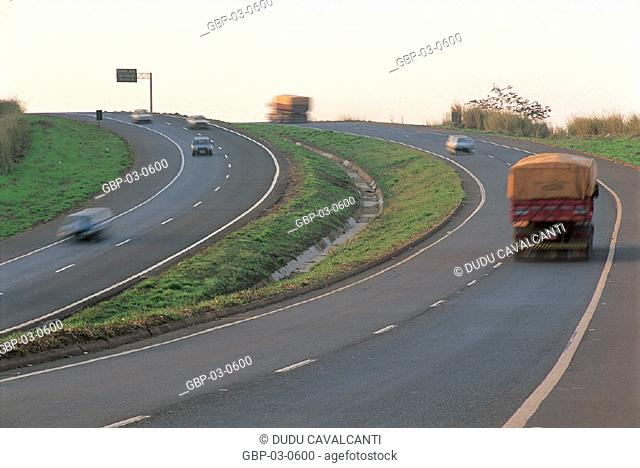 Photo illustrated a highway, lane, road, tracks, signs, vehicles, vegetation, plate