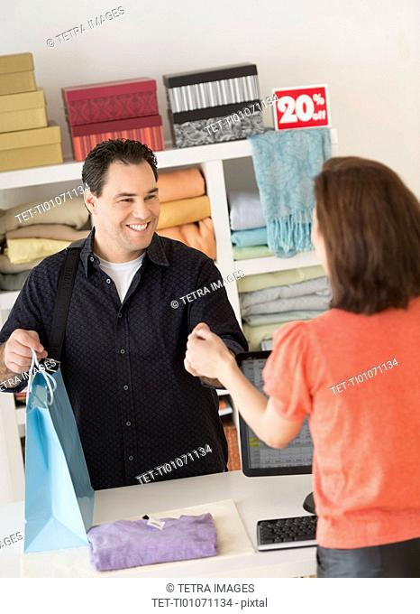 Customer paying in clothes store