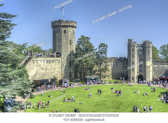 HDR image of visitors in the courtyard of Warwick Castle, Warwickshire, England