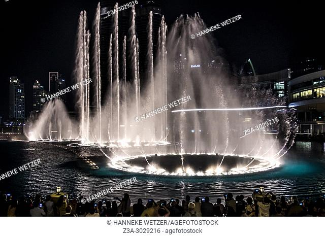 People watching the fountain show at the Burj Khalifa in Dubai, highest building of the world