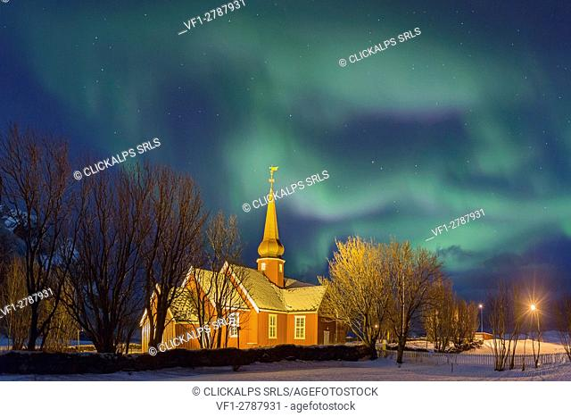 Flakstad Church in Lofoten Island under a powerful Aurora borealis, Norway