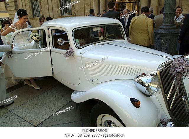 Bride entering a car, Provence, France
