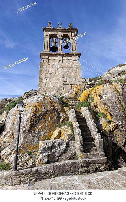 Muxía, Spain: Built into the ocean bluff is the bell tower of the Parish Church of Santa María de Muxía