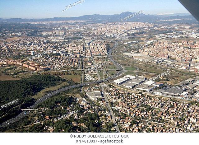 Spain, Catalonia, Barcelona, Barcelonés, Cerdanyola del Vallés (left), Sant Llorenç de Munt (top), N-150 road and C-58 freeway (autopista del Vallès)