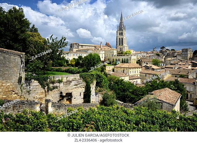 Vineyard overlooking the monolithic church of the village. France, Gironde, Saint Emilion, listed as World Heritage by UNESCO