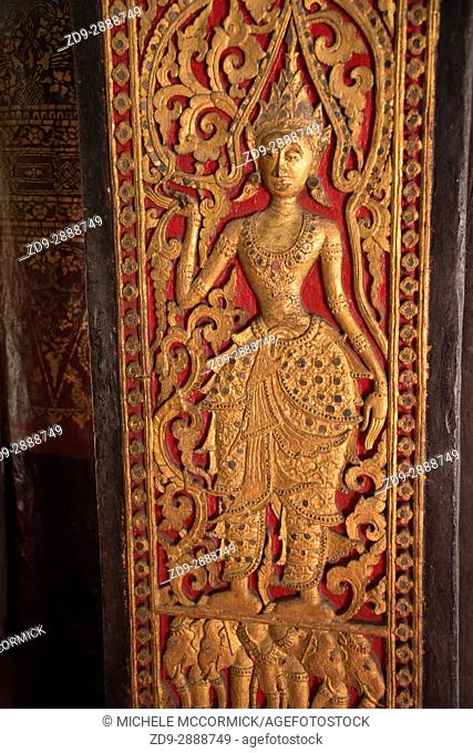 A carved figure decorates the temple Vat Sene in Luang Prabang