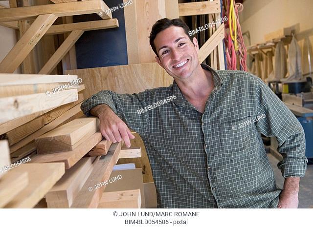 Hispanic man in wood shop