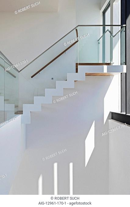 Modern internal staircase with glass balustrades