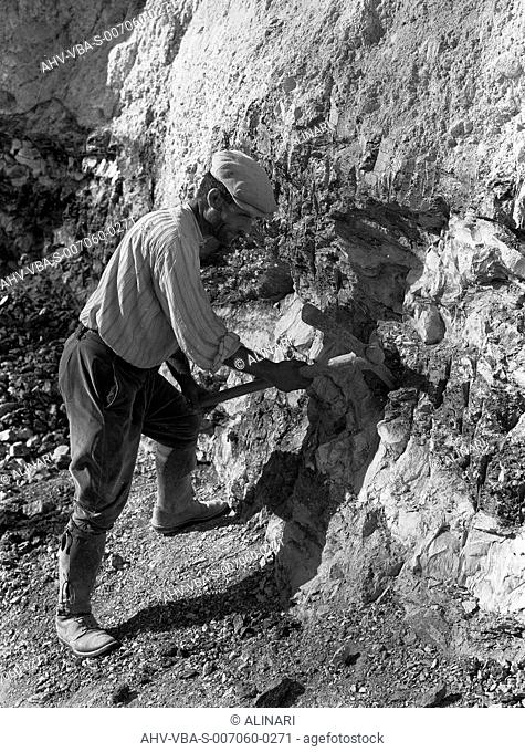 A worker in Laconi Cave. The image was commissioned by the ILVA factory of Genoa, shot 1940 - 1950 by Villani, Studio