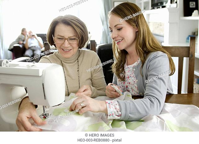 daughter sewing with senior mother