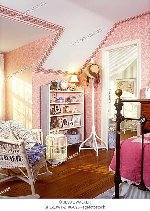 CHILDREN'S BEDROOM: Child's guest room. Bookcase with collectibles. Wicker chair