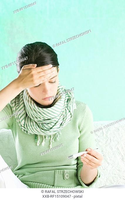 woman measuring body temperature