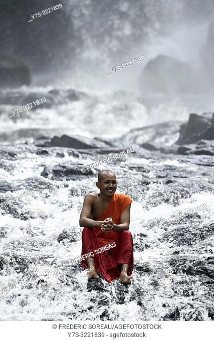 Novice monks play at Bou Sra waterfall near Sen Monorom,Mondolkiri province,Cambodia,South east Asia