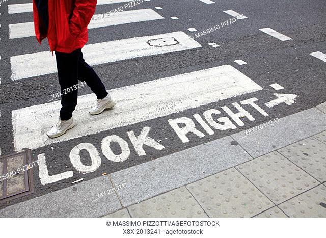 "Crosswalks with """"look right"""" warning, London, UK"