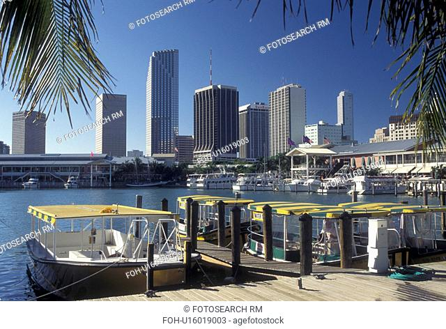 water taxi, Miami, FL, skyline, Florida, Atlantic Ocean, Yellow water taxi docked outside Bayside Marketplace, a shopping, dining, entertainment mecca