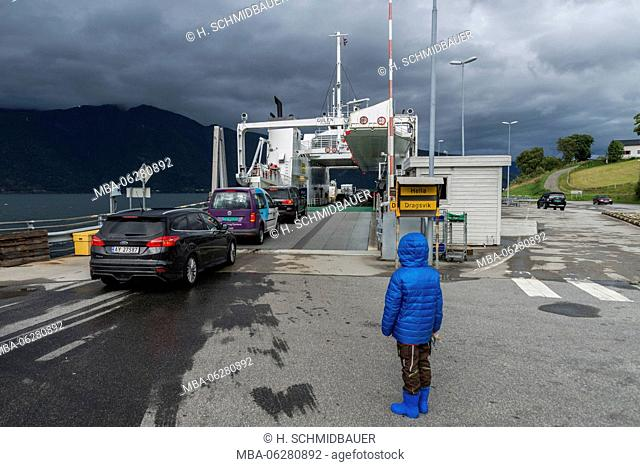 Child waiting for a ferry to Vangsnes, Norway, Scandinavia, Europe