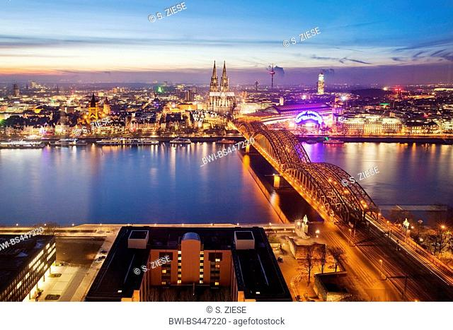city centre of Cologne with cathedral and bridge Hohenzollernbruecke over river Rhine at sunset, Germany, North Rhine-Westphalia, Rhineland, Cologne
