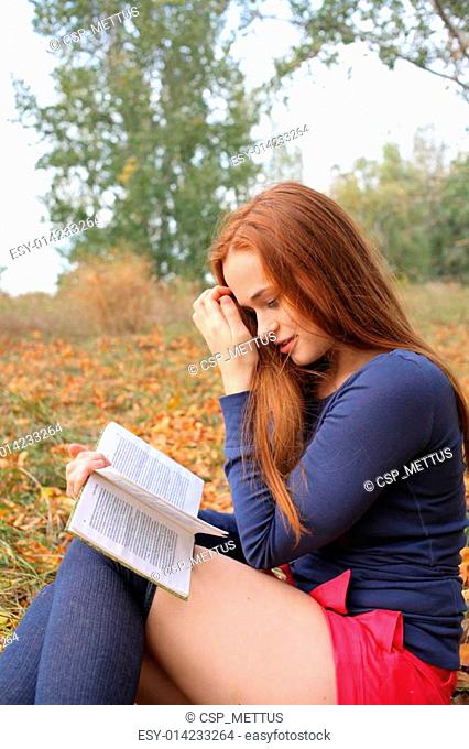 beautiful girl holding an open book